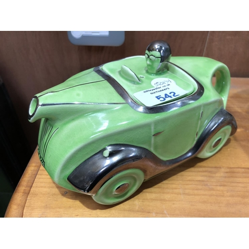 542 - A GREEN LUSTRE 'SADLER'S' CERAMIC MODEL OF A RACING CAR TEAPOT...