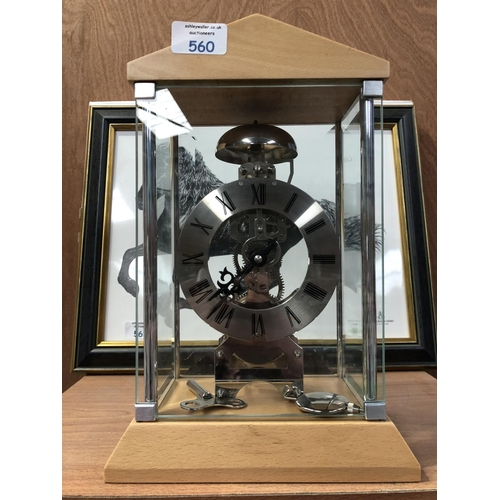 560 - A MODERN 'WOODFORD' BEECH CASED MECHANICAL CHIMING CLOCK WITH GLASS SWING DOOR, PENDULUM AND KEY...