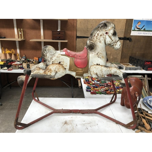 1163 - A VINTAGE METAL FAIRGROUND MODEL OF A HORSE ON RED STAND...