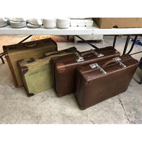 336 - FOUR VARIOUS VINTAGE SUITCASES TO INCLUDE CANVAS COVERED EXAMPLES (4)...
