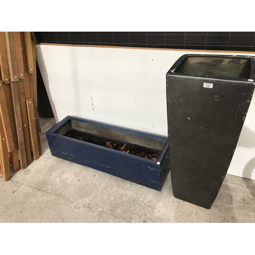 10 - TWO LARGE PLASTIC PLANTERS...