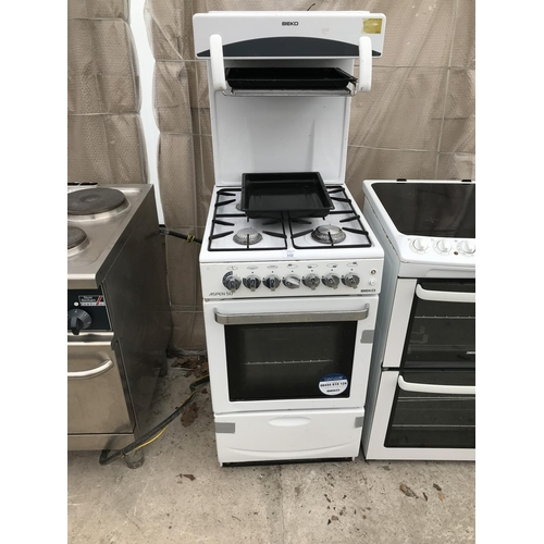 102 - A BEKO ASPEN 50 GAS COOKER WITH OVEN AND EYE LEVEL GRILL...