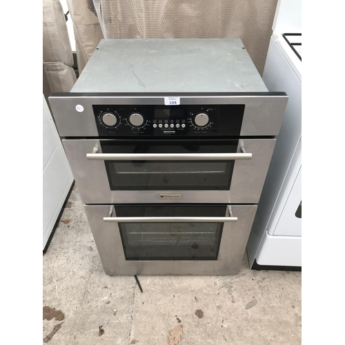 104 - A HOTPOINT BD40 CUPBOARD MOUNTED BRUSHED STEEL OVEN AND GRILL...