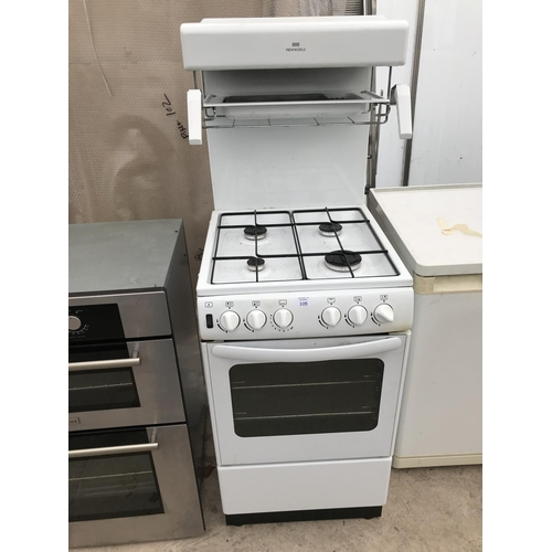 105 - A NEW WORLD GAS COOKER WITH OVEN AND EYE LEVEL GRILL...