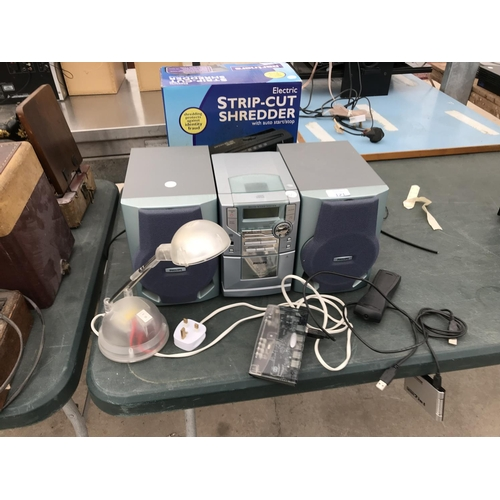 121 - A PHILIPS LX3600 STEREO, A TABLE LAMP, A USB SPLITTER ETC W/O...