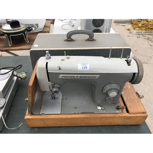125 - A VINTAGE FRISTER AND ROSSMANN CASED SEWING MACHINE...