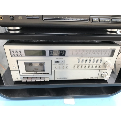 130 - A TOSHIBA SM-D30 STEREO MUSIC CENTRE, A TECHNICS SL-PG590 CD PLAYER AND TWO TEN SPEAKERS W/O...
