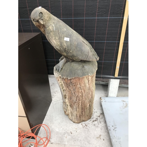 15 - A CARVED TREE STUMP IN THE FORM OF AN OWL...