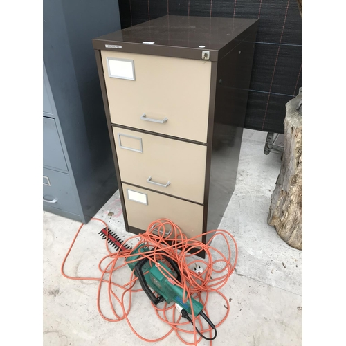 16 - AN ESCOLINE THREE DRAWER METAL FILING CABINET AND A QUALCAST HEDGE TRIMMER W/O...