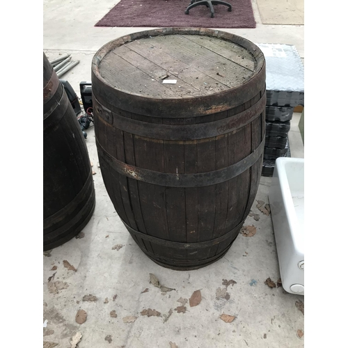 24 - A VINTAGE OAK BARREL...