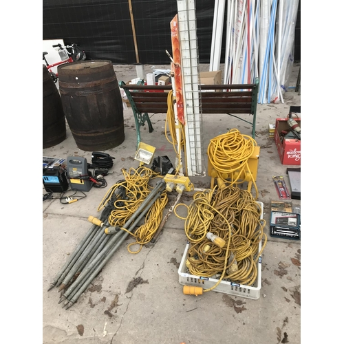33 - A LARGE QUANTITY OF 110 VOLT LIGHTS, CABLE, SPLITERS ETC...
