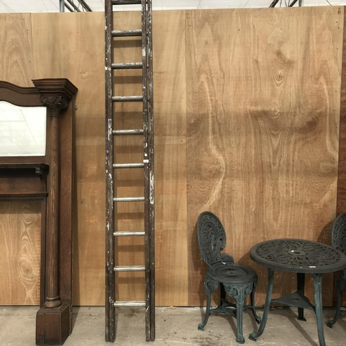 45 - A 26 RUNG TWO SECTION WOODEN LADDER WITH ALLOY RUNGS...