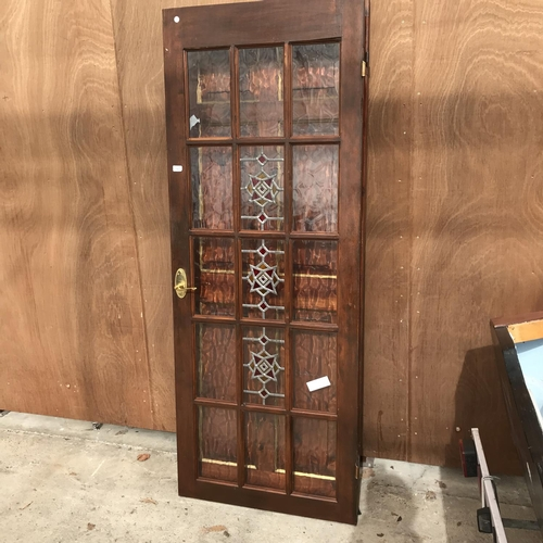53 - TWO WOODEN DOORS - ONE LEADED GLAZED 195CM X 75CM AND ONE PANELLED...