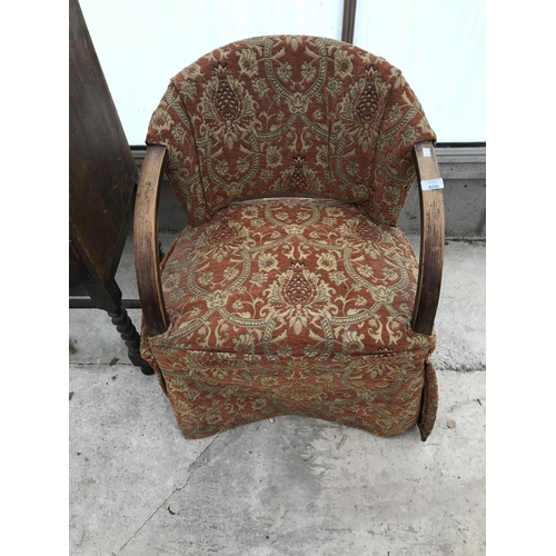 606 - AN UPHOLSTERED OAK SITTING ROOM ARMCHAIR...