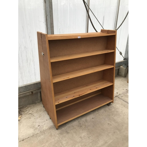 610 - A PINE DOUBLE SIDED BOOKCASE...