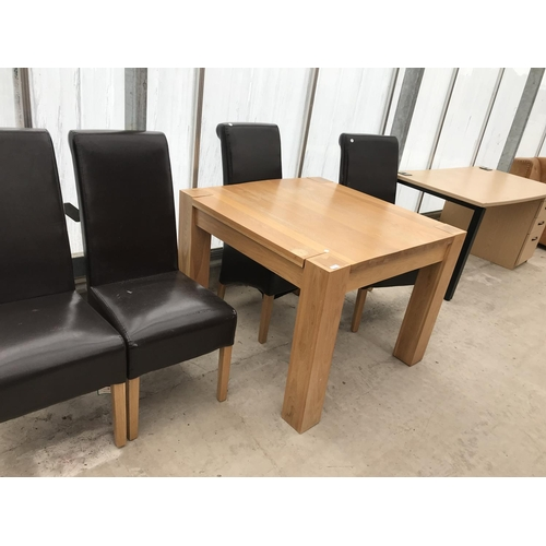 611 - SIX ITEMS - A MODERN SQUARE OAK TABLE, FOUR  OAK AND LEATHERETTE DINING AND A BEECH EFFECT DESK...
