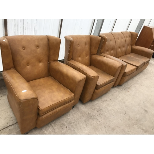 612 - A RETRO TAN LEATHER THREE PIECE SUITE WITH STUDDED BACKS, COMPRISING A THREE SEATER SOFA AND TWO ARM...