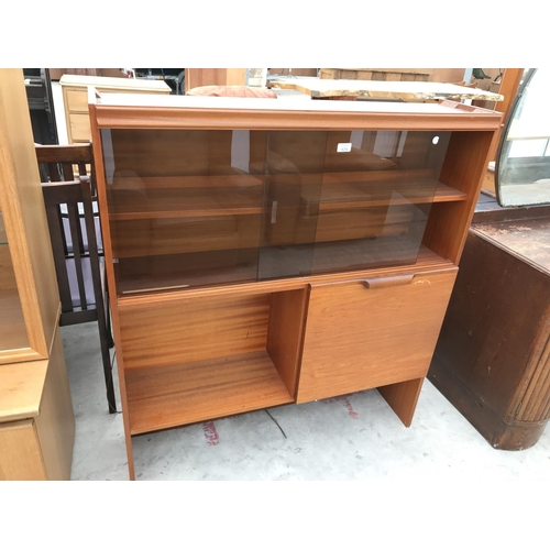 626 - A TEAK CABINET WITH LOWER DOOR AND TWO DRAWERS AND TWO UPPER SMOKED GLASS SLIDING GLASS DOORS...