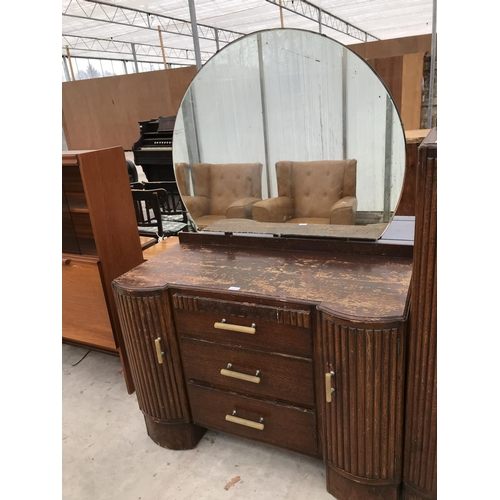 627 - AN ART DECO OAK DRESSING TABLE WITH TWO DOORS, TWO DRAWERS AND CIRCULAR MIRROR AND A MATCHING TALLBO...