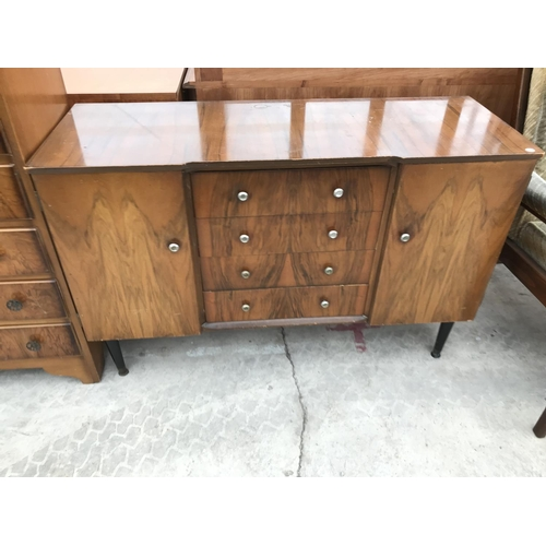 637 - A WALNUT CHEST OF SIX DRAWERS AND A WALNUT SIDEBOARD WITH TWO DOORS AND FOUR DRAWERS...