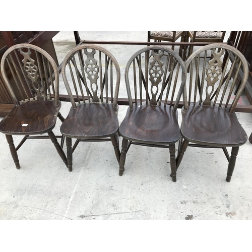 641 - FOUR OAK WHEELBACK DINING CHAIRS...