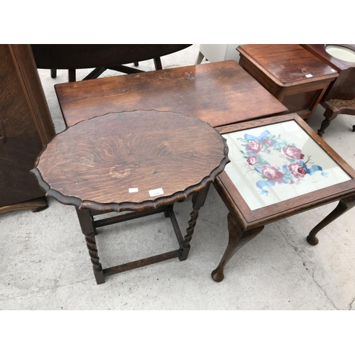 643 - AN OAK COFFEE TABLE AND TWO OAK OCCASIONAL TABLES - ONE ON BARLEY TWIST SUPPORTS AND ONE WITH TAPEST...