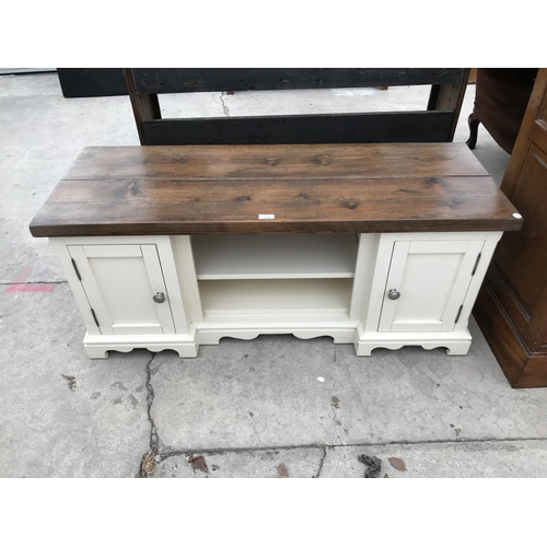 649 - A PINE AND PAINTED SIDEBOARD WITH TWO DOORS AND CENTRE SHELVING...