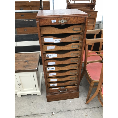 650 - A TALL RETRO OAK OFFICE CABINET WITH 9 DRAWERS AND CONCERTINA ROLL UP DOOR (DOOR WORKS BUT NO KEY)...
