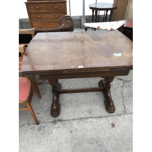 652 - TWO TABLES - ONE OAK DRAW LEAF AND ONE TEAK DROP LEAF...