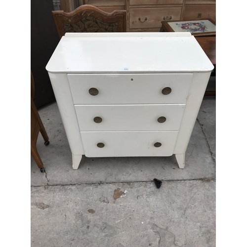 653 - A WHITE PAINTED CHEST OF THREE DRAWERS...