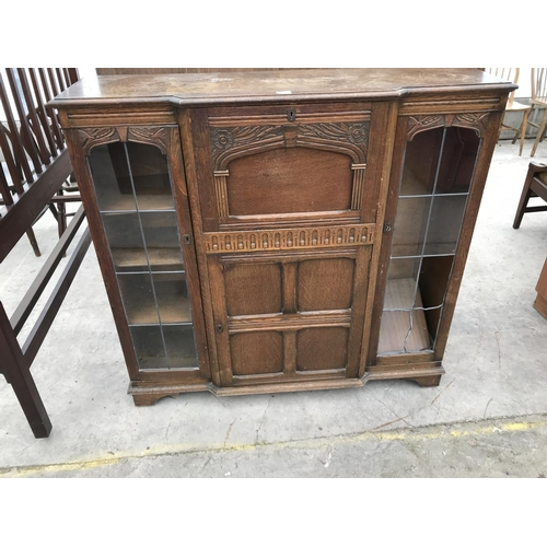 657 - AN ARTS SND CRAFTS STYLE OAK SIDE-BY-SIDE DISPLAY CABINET WITH LEADED GLASS PANES, CENTRE DOOR AND C...