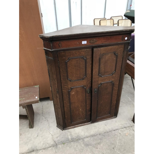 661 - AN OAK FLAT FRONT CORNER CUPBOARD WITH TWO DOORS AND INLAID DECORATION...