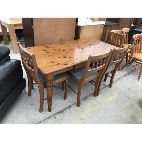 665 - A PINE DINING TABLE AND FOUR PINE DINING CHAIRS...