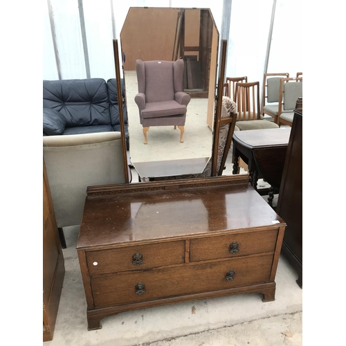 674 - A THREE PIECE BEDROOM SUITE - A WARDROBE, DRESSING TABLE WITH UNFRAMED MIRROR AND A TALLBOY...