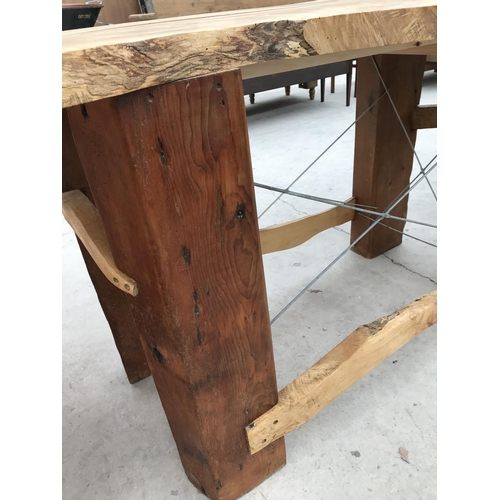 681 - A RUSTIC SAWN TOP SYCAMORE DINING TABLE ON VERY HEAVY SUPPORTS - APPROX 220 CM X 95 CM...
