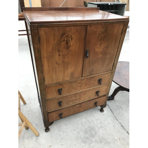 684 - A MAHOGANY TALLBOY WITH TWO DOORS AND TWO DRAWERS...