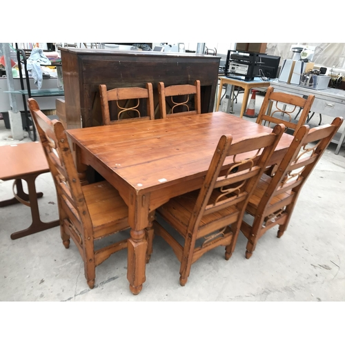 699 - A HEAVY PINE DINING TABLE AND SIX MATCHING DINING CHAIRS...