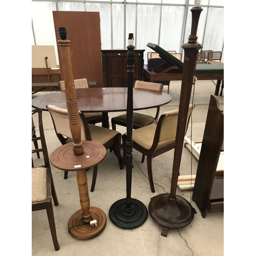 711 - THREE STANDARD LAMPS - ONE TEAK, TWO OAK...