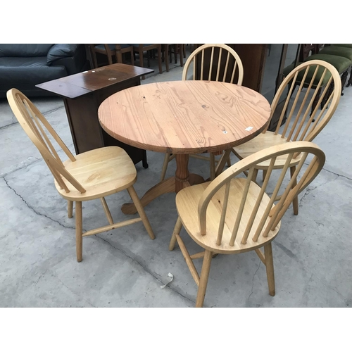 715 - A CIRCULAR PINE DINING TABLE ON CENTRE PEDESTAL SUPPORT AND FOUR MATCHING DINING CHAIRS...