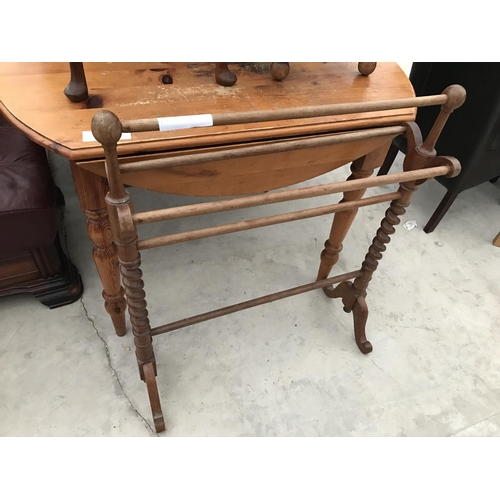 719 - SIX ITEMS - A LLOYD LOOM STYLE CHAIR, A LEATHER FOOT STOOL, A PINE TABLE, A TOWEL RAIL, AND TWO SMAL...