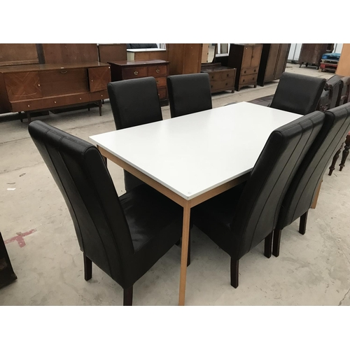 720 - A WHITE TOPPED BEECH DINING TABLE AND SIX MODERN HIGH BACKED LEATHER DINING CHAIRS...