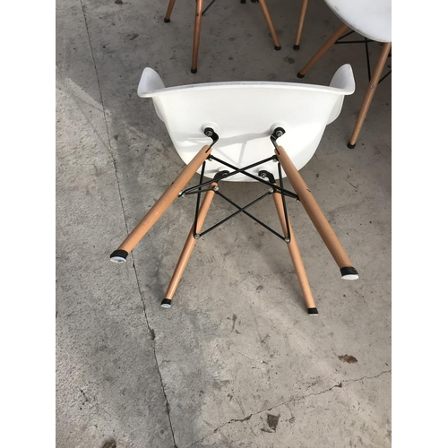 723 - FOUR 'DAW' MID CENTURY MODERNIST PLASTIC DINING ARMCHAIRS WITH WALNUT EIFFEL LEGS...