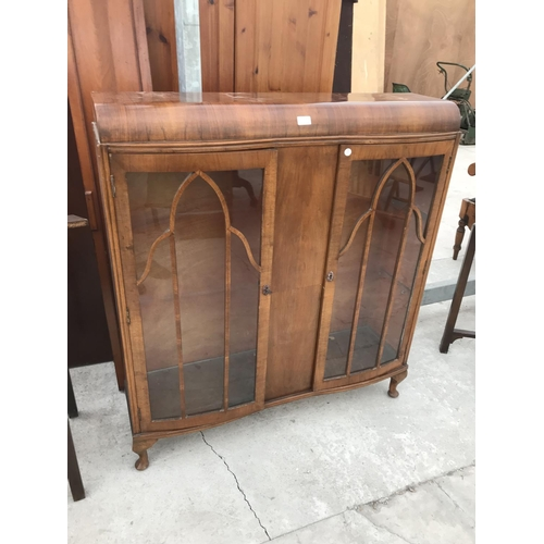 731 - A WALNUT CHINA CABINET WITH TWO GLAZED DOORS...