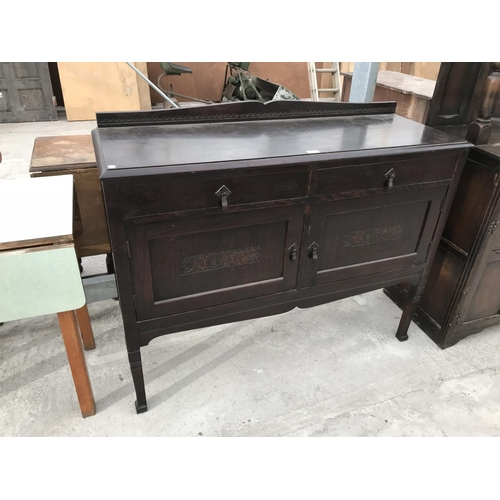 734 - AN OAK SIDEBOARD WITH TWO DOORS AND TWO DRAWERS...