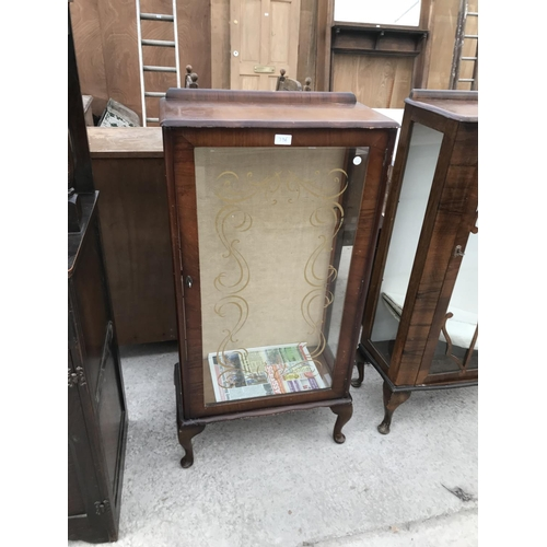 736 - A SMALL WALNUT CHINA CABINET WITH ONE DOOR...