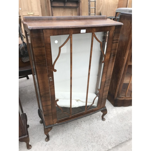 737 - A WALNUT CHINA CABINET WITH ONE DOOR...