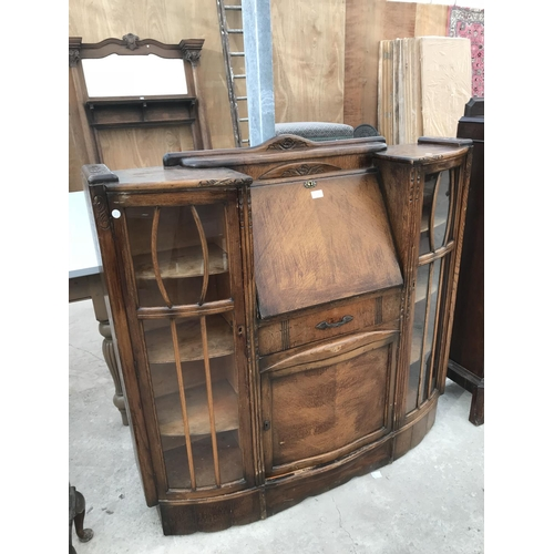 738 - AN OAK BUREAU CABINET WITH FALL FRONT, CENTRE DOOR AND DRAWER AND TWO GLAZED SIDE DOORS...