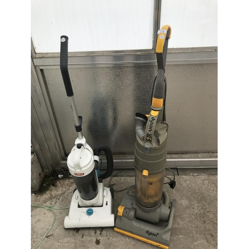 115 - TWO VACUUM CLEANERS - A DYSON DC04 AND A VAX BOTH W/O...