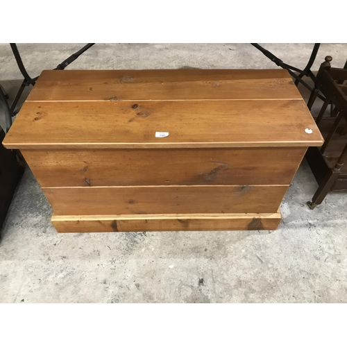 295 - A PINE LIDDED BLANKET BOX MADE FROM CHURCH PEW BOARDS...