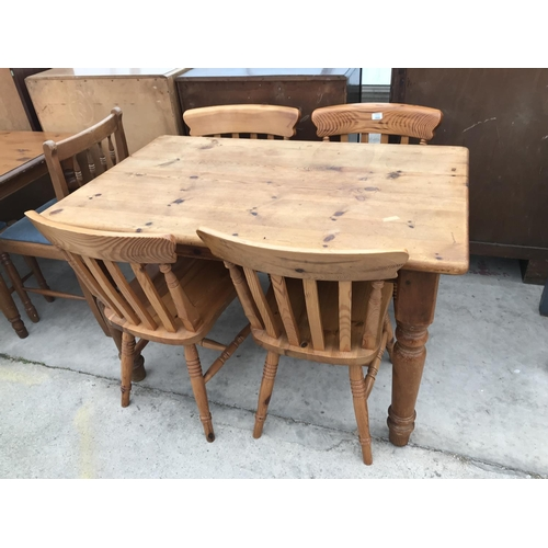 666 - A PINE DINING TABLE AND FOUR PINE DINING CHAIRS...